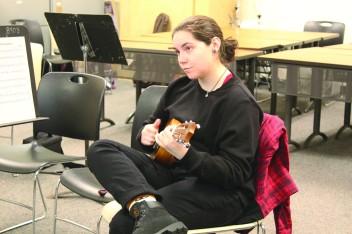 Natalie Salvador strums a tune. photo by Reece Roth/MainSheet