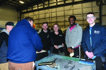 Nate Ward, Samantha Pena, Kyle Cardoza, Emmanuel Ezema and Jacob Twigg in welding class. Photo by Bruce McDaniel/MainSheet