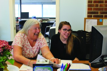 Judy Widger and Katie Huegel in the Cape Cod Educational Foundation Office. Photo by Reece Roth/MainSheet